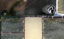 Schliffbildanalyse: Querschliff einer Durchkontaktierung an einer Leiterplatte